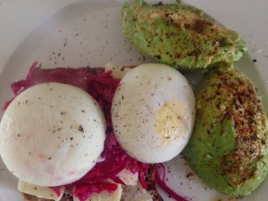 Poached Eggs with Avo on rye bread with Kimchi