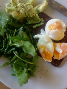 Eggs on Rye Bread with rocket and Avo